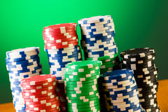 Stack of casino chips against gradient Royalty Free Stock Photography