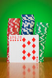 Stack of casino chips against gradient Stock Image