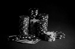 Stack of casino chips. dollar bills on the poker table. Black and white photo Royalty Free Stock Photography