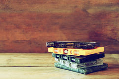 Stack Cassette tapes over wooden table. retro filter Royalty Free Stock Photo