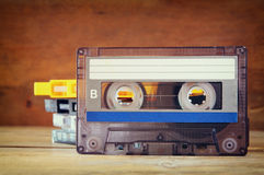Stack Cassette tapes over wooden table. retro filter Stock Photos