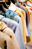 Stack of casual coat on hangers Stock Image