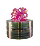 Stack of CD disks with pink gift lace over white Royalty Free Stock Images