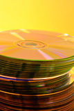 Stack of Cds. On yellow background stock photography