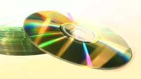 Stack of CDs, isolated, focus-out stock video footage