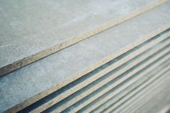 Stack of cement-bonded panels for home construction Stock Photos