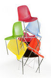 Stack of chairs. A stack of colorful modern chairs stock photo