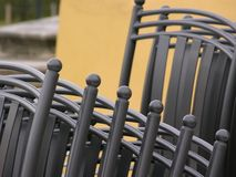 Stack of chairs. Closeup of stacks of gray chairs outdoors Royalty Free Stock Images