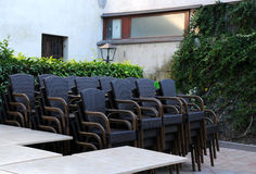 Stack of Chairs in the Courtyard Restaurant Royalty Free Stock Image