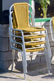 Stack of chairs outside cafe Royalty Free Stock Photography