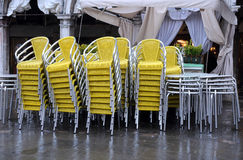 Stack of Chairs and Tables in the Fall Royalty Free Stock Photo