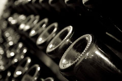 Stack of champagne bottles in the cellar. Horizontal perspective view of rows of many champagne bottles in a wine cellar Stock Photography