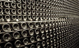 Stack of champagne bottles in the cellar Royalty Free Stock Photo