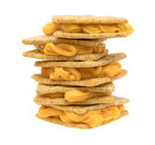 Stack of cheese filled crackers on a white background Royalty Free Stock Images