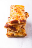 Stack of cheese pizza slices close up on white board royalty free stock photo