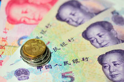 Chinese coins on banknotes Royalty Free Stock Photo