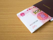 Stack of Chinese yuan banknotes money in passport royalty free stock photos