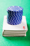 Stack of chips on card deck Royalty Free Stock Image