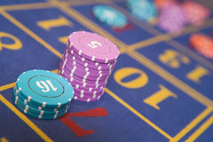 Stack of chips on roulette table. On number seven Stock Photography