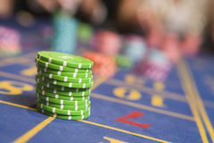Stack of chips on roulette table. In casino Stock Image