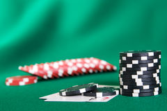 Stack of chips and two aces. On green linen background stock images