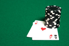 Stack of chips and two aces. On green linen background stock photo