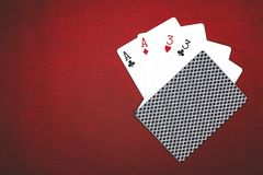 Stack of chips and two aces on a red poker table stock photography