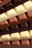 Stack of chocolate. Different sorts of chocolate in a stack stock photography