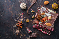 Stack of chocolate bars and praline truffle with spices Royalty Free Stock Image