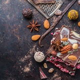 Stack of chocolate bars and praline truffle with spices Royalty Free Stock Photo