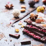 Stack of chocolate bars and praline truffle Royalty Free Stock Photos