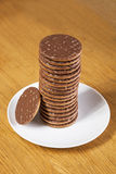 Stack of chocolate biscuits in plate Royalty Free Stock Photography