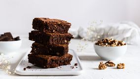 A stack of chocolate brownies on white background, homemade bakery and dessert. Bakery, confectionery concept. Side view, copy royalty free stock photography