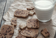 Stack of Chocolate chip cookie and glass of milk Royalty Free Stock Images