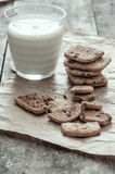Stack of Chocolate chip cookie and glass of milk Stock Image