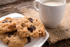 Stack of Chocolate chip cookie and glass of milk Stock Images