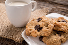 Stack of Chocolate chip cookie and glass of milk Royalty Free Stock Image