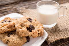 Stack of Chocolate chip cookie and glass of milk Stock Photos