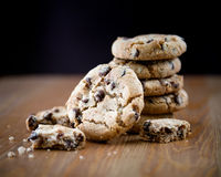 Stack of chocolate chip cookies on wooden table. Shallow DOF. Close up of stacked chocolate chip cookies on wooden background Royalty Free Stock Photo