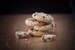 Stack of chocolate chip cookies on wooden table. Shallow DOF. Fo Royalty Free Stock Photography