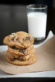 Stack of chocolate chunk cookies wtih glass of milk Royalty Free Stock Image