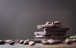 Stack of chocolate chunks with coffee beans Royalty Free Stock Photography
