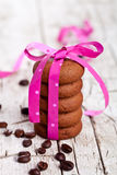 Stack of chocolate cookies tied with pink ribbon and coffee bean Stock Photography