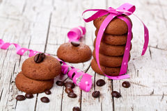 Stack of chocolate cookies tied with pink ribbon and coffee bean Royalty Free Stock Photography