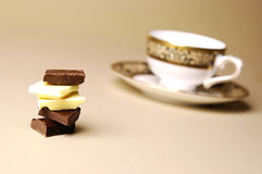 Stack of Chocolate and Cup Royalty Free Stock Photography