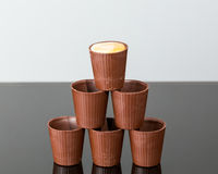 Stack of chocolate cups with liqueur Royalty Free Stock Image