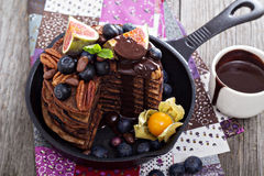 Stack of chocolate pancakes. Decorated with berries Stock Photo