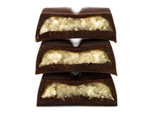Stack of chocolate pieces with marzipan filling Royalty Free Stock Photos