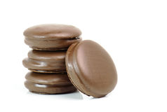 Stack of chocolate pieces on a white background Stock Photo