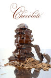 Stack of chocolate on reflective glass Stock Images